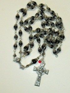 "Wire-wrapped by hand. Celtic cross with a ""drop of His blood"" $36"